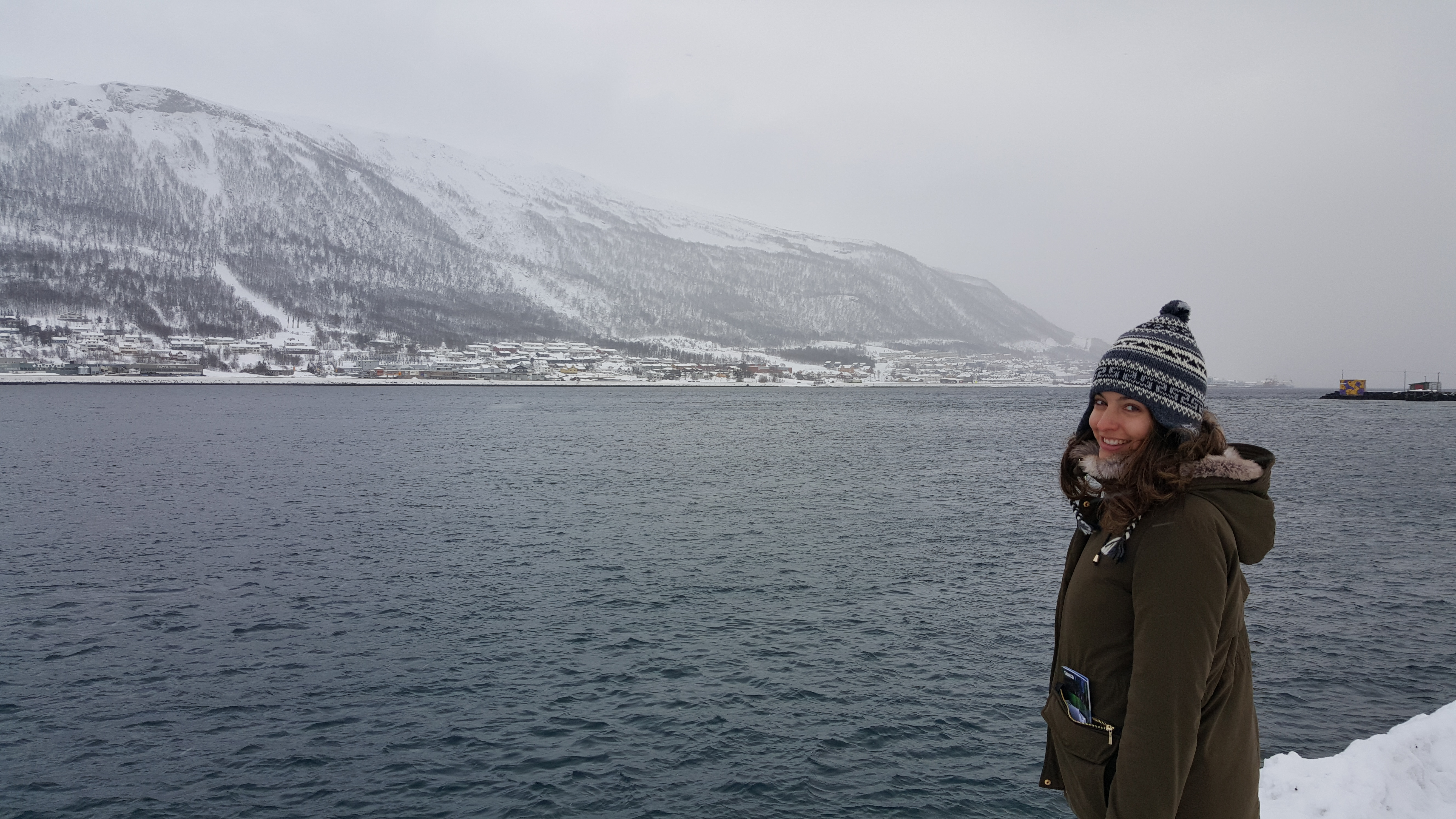 Strolling around the beautiful snowing coast of Tromso